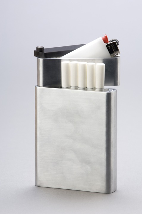 This cigarette holder provides a solution for wandering lighters. There are two sections in this piece, the bottom part offers space for 8 cigarettes, and the top part offers space for a lighter that won't walk away.
