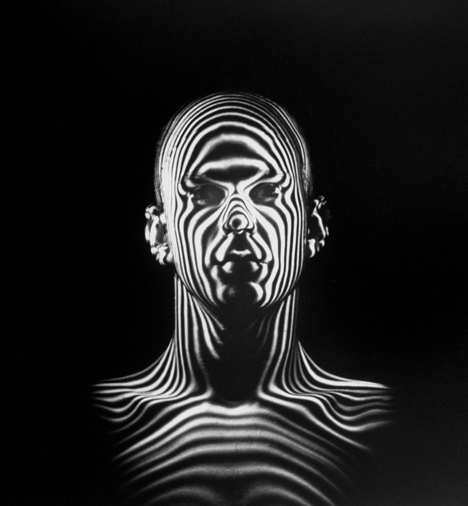 Light beams create a contour map of a human head during an Air Force study of jet-pilot helmets.  Originally published, as the cover image, on the December 6, 1954, issue of LIFE.      (see more  here )