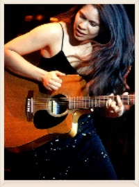 Old-school photo of singer Lisa playing at the Detroit Music Awards back in 2001.