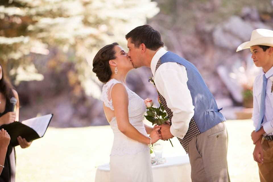A blessing, then pronouncement as husband & wife...then the kiss!