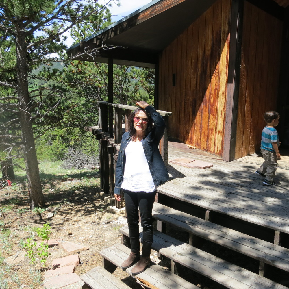 Mom outside my Dad's cabin