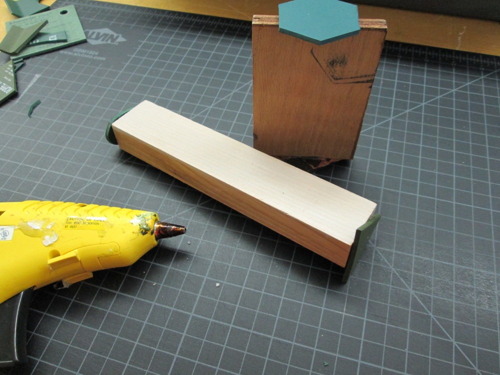 Hot gluing them on to extra wood samples to create a handle for the stamp