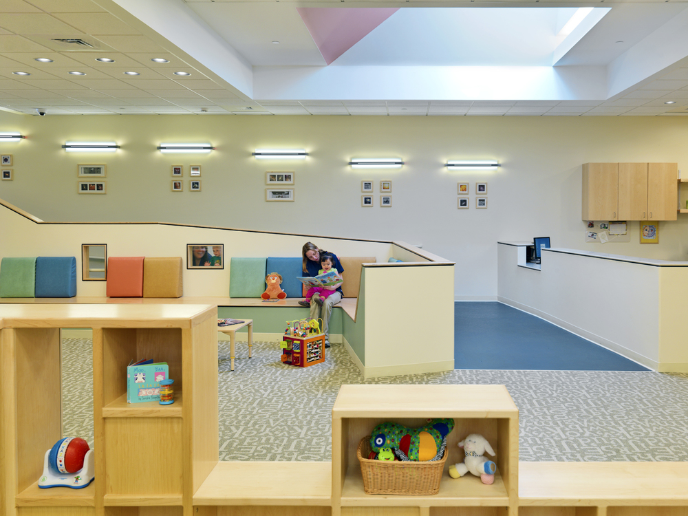The entrance lobby transition space provided ample area for parents and children to read together at the  U. Mass Child Care Center