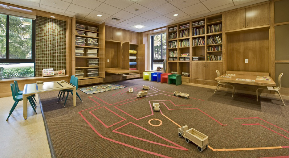 This large, multipurpose communal space hosts varied conversations among teachers and students at  The Children's Center   at Harvard Business School