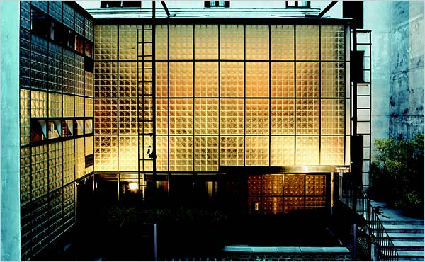 "The iconic image of Maison de Verre's glass block facade lit from within. Image: ""La Maison de Verre,"" published by Thames & Hudson"