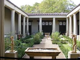 Roman house courtyard with peristyle colonnade and in-sloping roof.