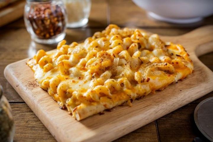 MAC N' CHEESE - Grab a slice of our Mac n' Cheese pizza for $4 OR a bowl of our Mac n' Cheese pasts for $5