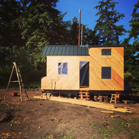 Raphael's Tiny House in it's new home - all sheathed using traditional diagonal sheathing (no plywood!)