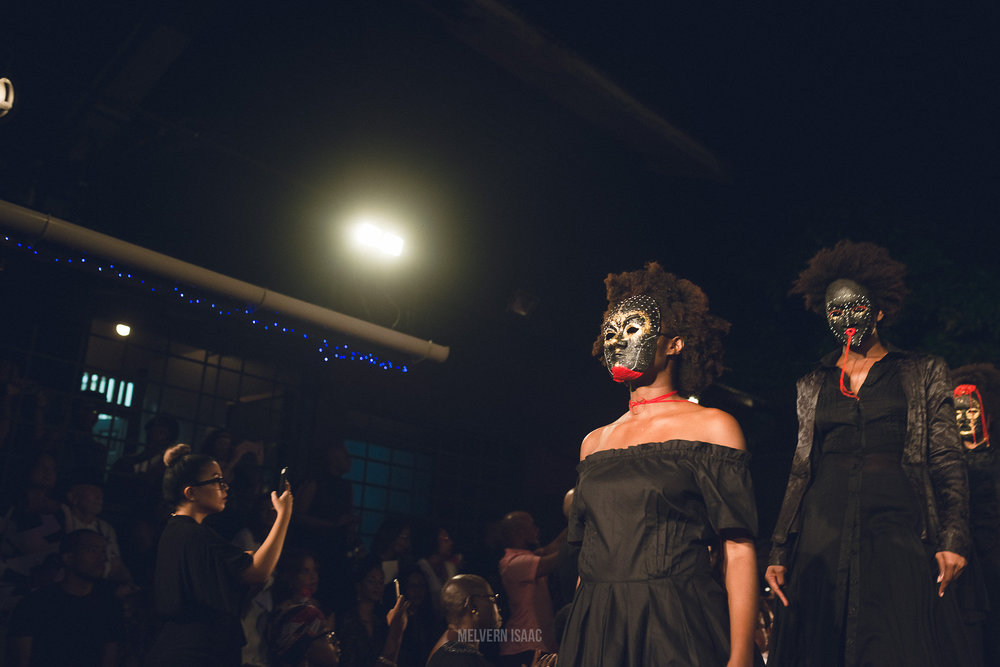 'Meiling launched her new 2016 collection entitled 'Night Women' at The Big Black Box on Murray Street, Trinidad. The collection was strongly inspired by the novel 'The Book Of Night Women' written by Jamaican author Marlon James. The theme encompassed Jamaican slavery in the 18th century and included an introductory mini production of the novel's protagonist a young enchanting slave named Lilith. The runway show commenced with a sort of reincarnation of 'The Night Women' walks, as the models made their way from Meiling's place on 6 Carlos Street to The Big Black Box on foot already dressed for the show.' Photography: Melvern Isaac (2015)