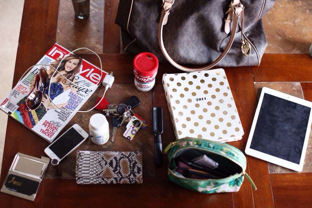iPad, makeup, Kate Spade Planner, brush, wallet, keys, lunch, phone, charger, sunglasses, business cards, Advil, not the latest Instyle (I'm behind!) and not pictured is obviously my camera.