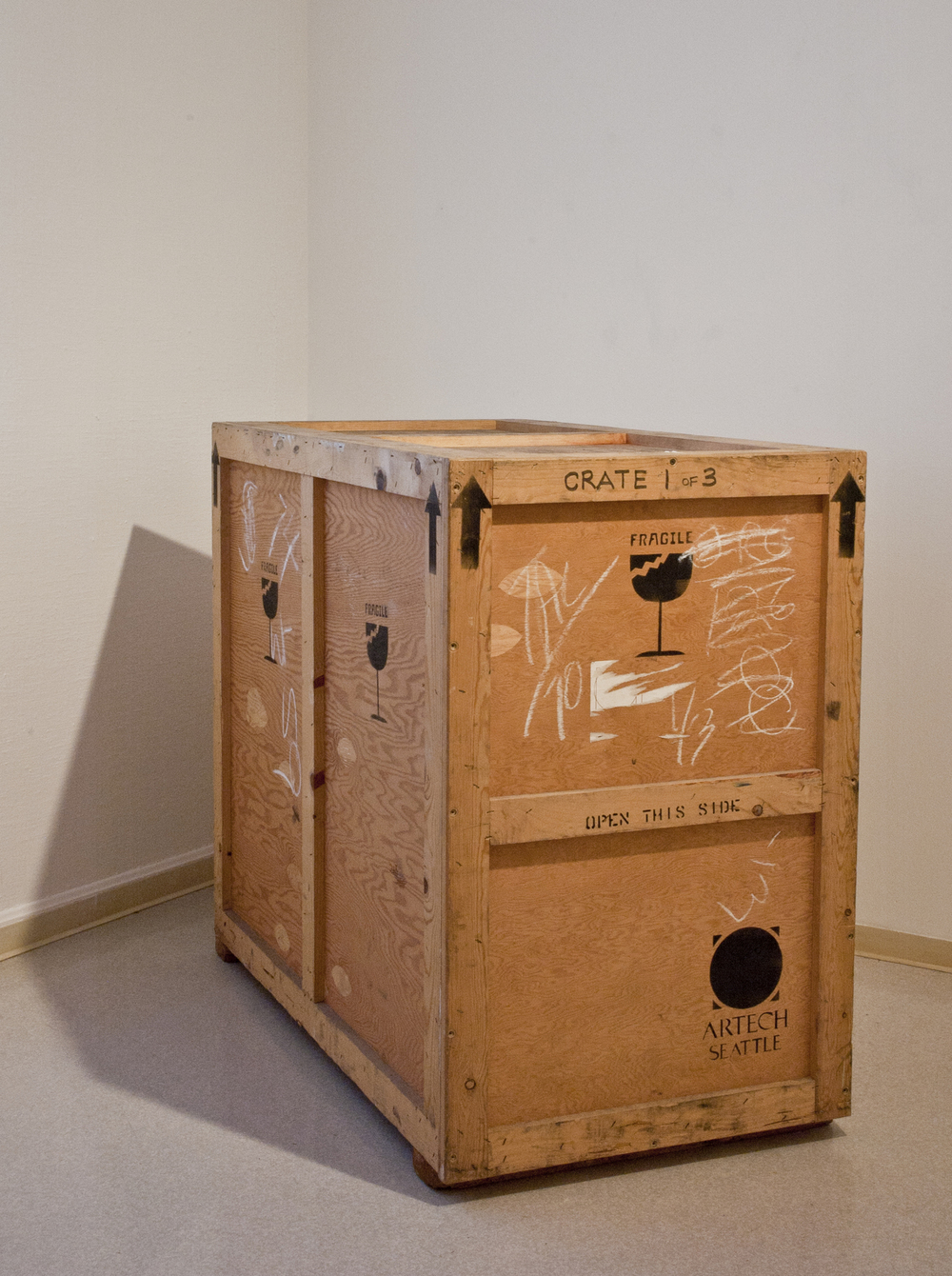 "Contained   2011  shipping crate, audio  27"" x 50"" x 43"""