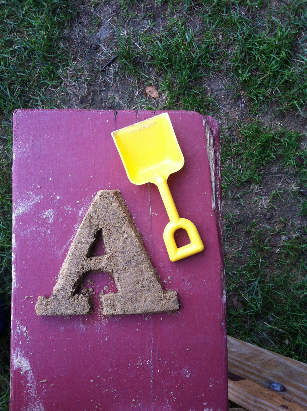July 7: A is for Abakee. Sand art at the picnic table.