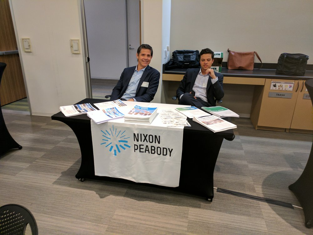 Event sponsors at leading law firm Nixon Peabody prepare to receive conference attendees.