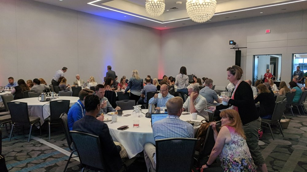 TECNA participants discuss the business of the organization during a working breakfast at the 2018 Summer Conference in Des Moines, Iowa.