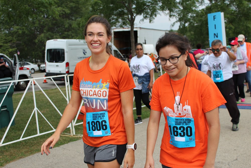 Erin with a Chicago Run participant at the 2017 Lung Run 5k.