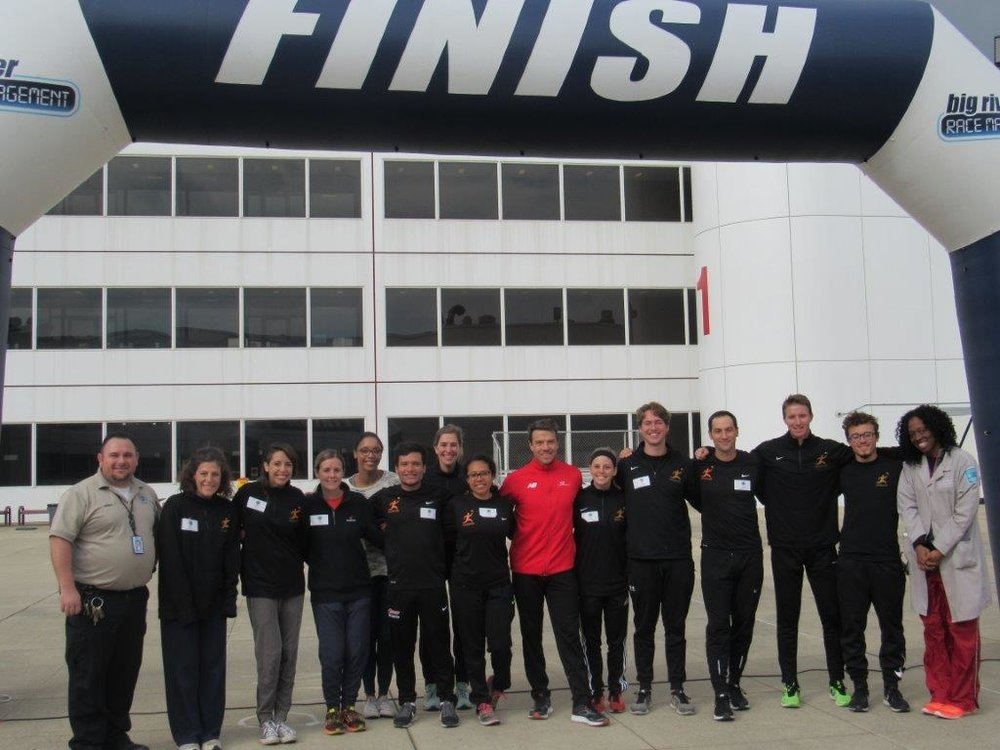 Chicago Run team, Dr. Ezike and JTDC staff, and me peeking out from behind after a successful race day.