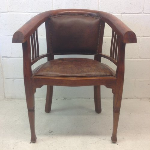 solid wood and leather captains chair vintage store love