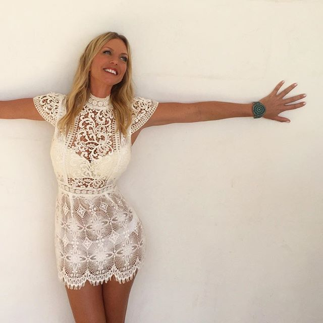 "Up against a wall wearing a few of my favourite things.... Custom made @byweave French lace dress 💫 A sincere smile 💫 my ""Navajo Baby"" hand  crafted natural turquoise cuff. 💫 and love and support from the best team! I hope you have something to love and smile about today.... it's not always easy but we must not forget the little things... all my best energies your way legends. 🔥"