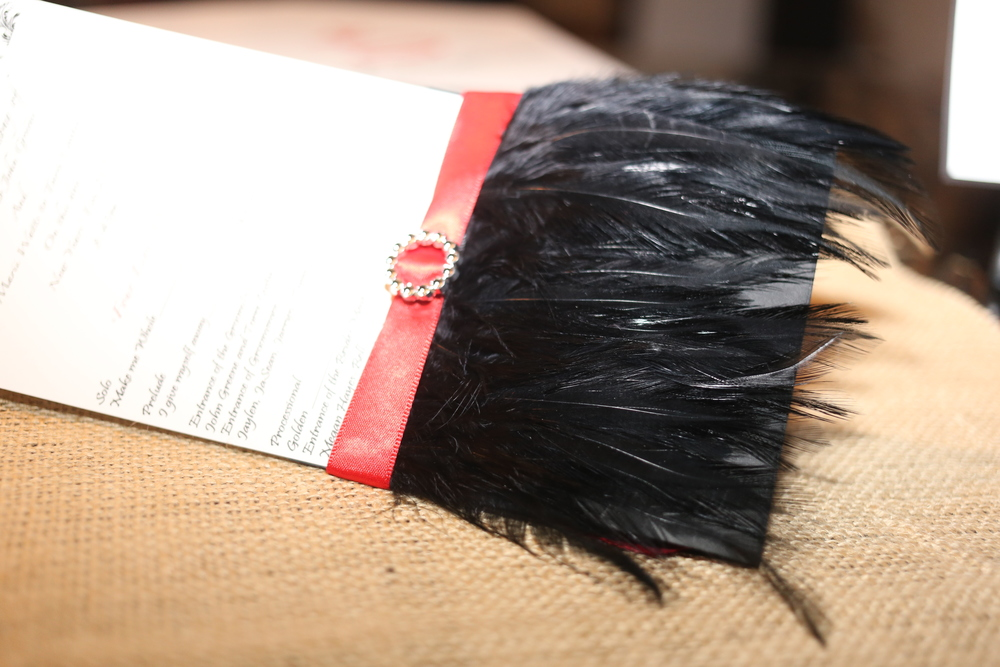 Pocket-Styled Program Holder with Feathers