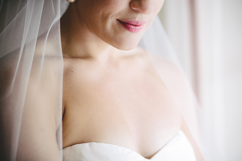 Close up of brides smile and pink lips.