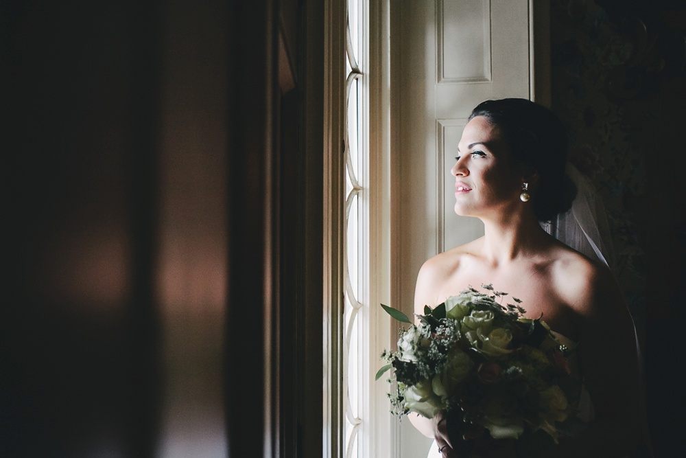 Bride looks out the window at The Briars.