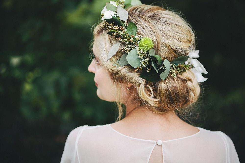 Bride wears beautiful flower crown by Crown Flora.