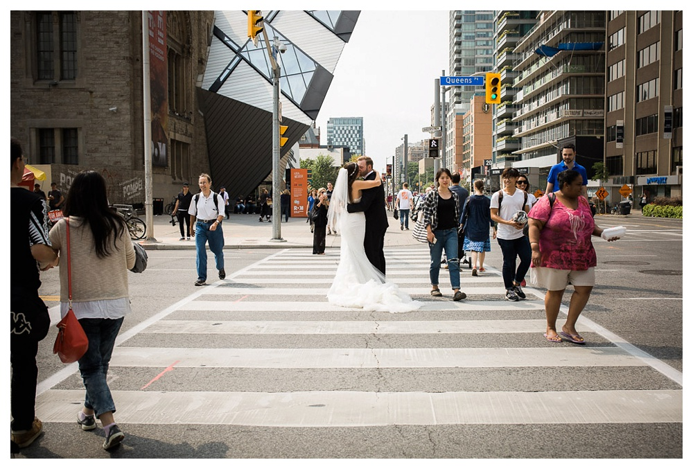 White Toronto, luxe, wedding, wedding dress, Gardiner Museum, 99 Sudbury, Ashley Lindzon, The ROM, Toronto, street, kiss, love, couple, bride and groom, Royal Ontario Musuem, crosswalk, Inbal Dror