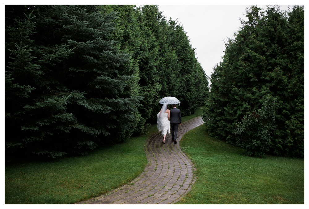 20-DanijelaWeddings-KurtzOrchards-Niagaraonthelake-wedding-couple-rain-umbrealla.JPG
