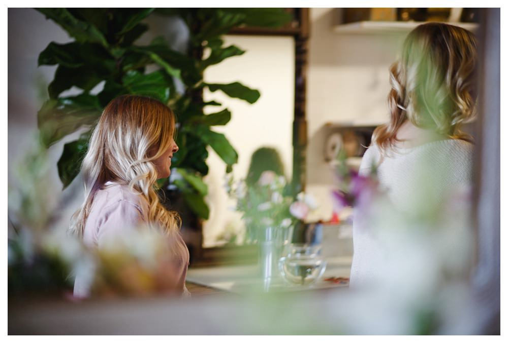Woman listening at a flower worshop.
