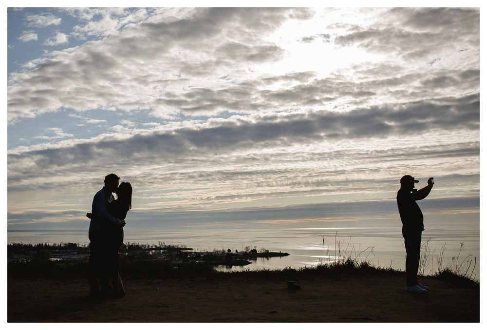The sky, setting sun, lake Ontario and Scarborough Bluffs are home to this wedding couple's love.
