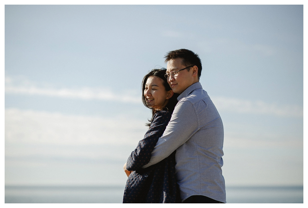 Nothing but sky, lake, sunshine and smiles on this engagement photo shoot in Toronto.