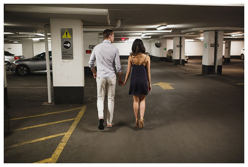 Downtown Toronto in the underground parking garage, the bride and groom begin their journey of their engagement photos.