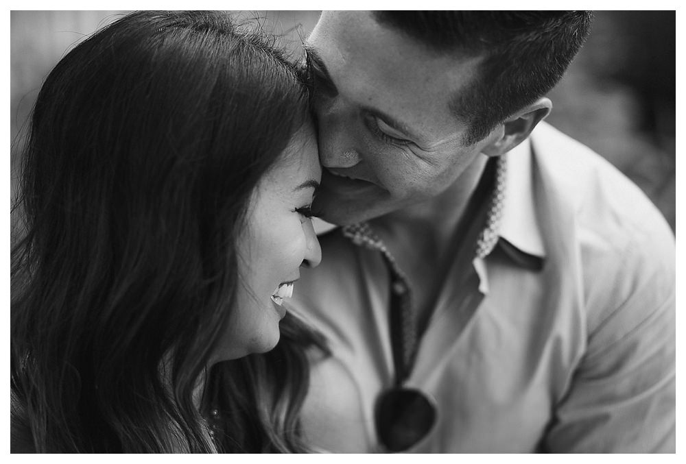 Black and white engagement photos capture the love of the bride and groom.