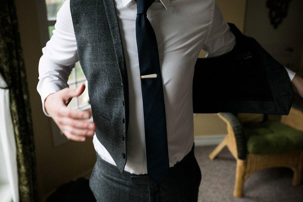 Groom getting dressed for Niagara wedding.