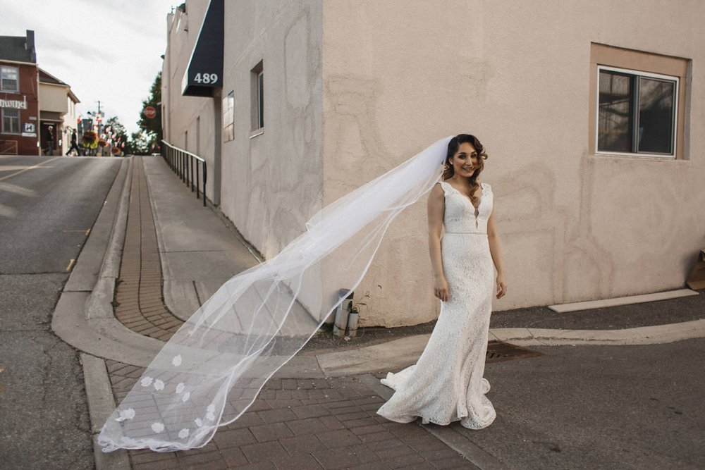 Bride's veil flowing in France like wedding scene.