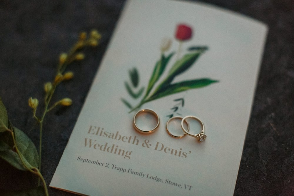 Rings and invitations at Vermont wedding.