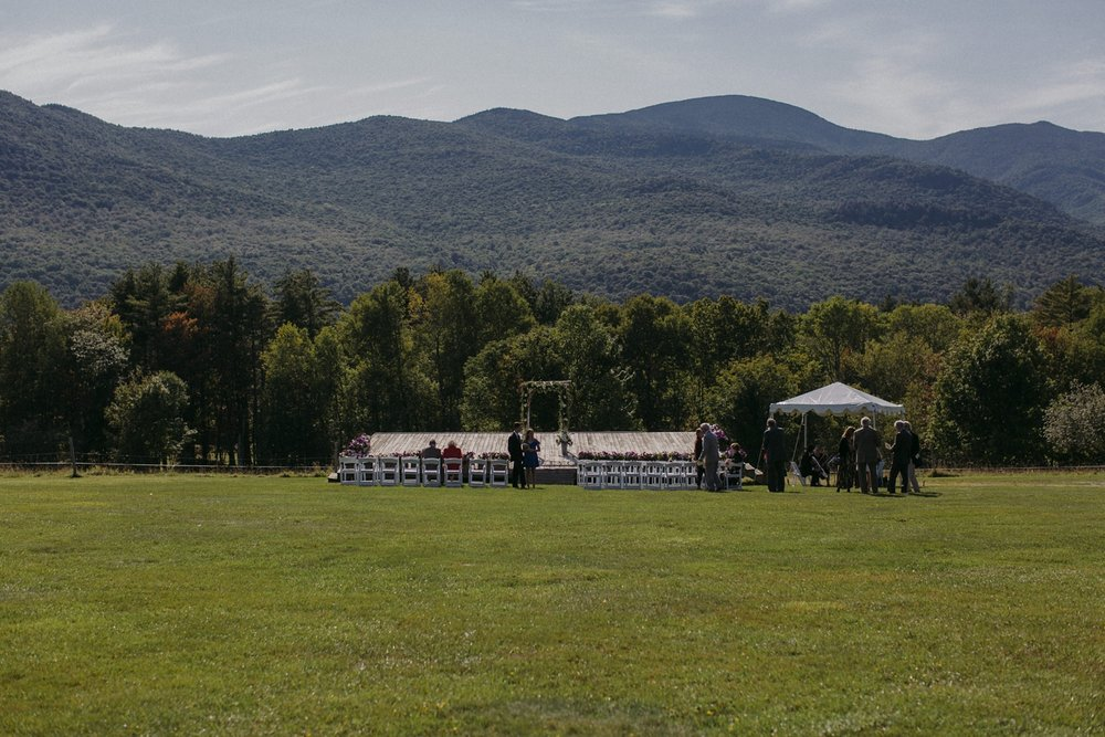Ceremony in meadow and hills at Trapp Lodge Vermont.