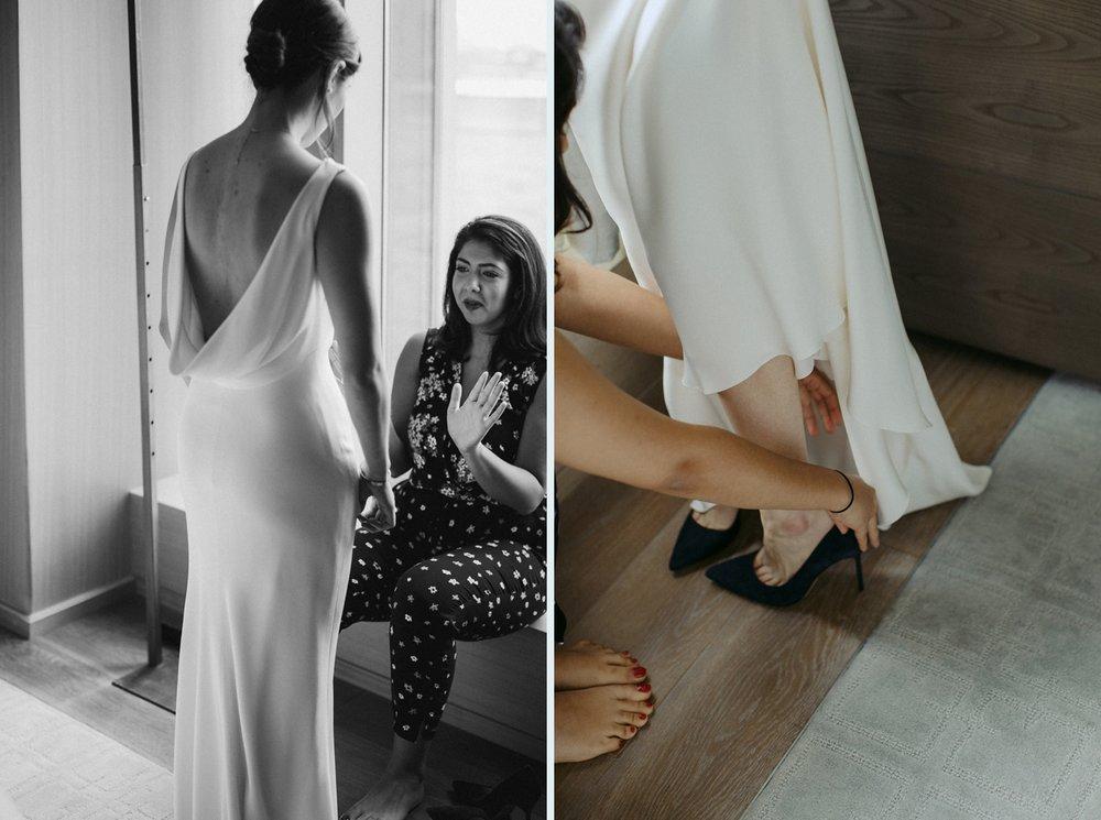 Bride in modern White Toronto wedding gown.
