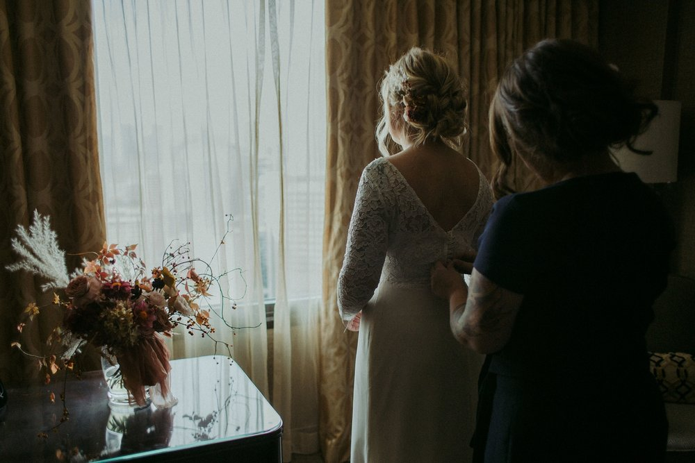 Bride getting dressed for Toronto elopement.
