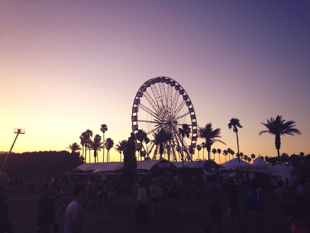 The sun sets over the ferris wheel