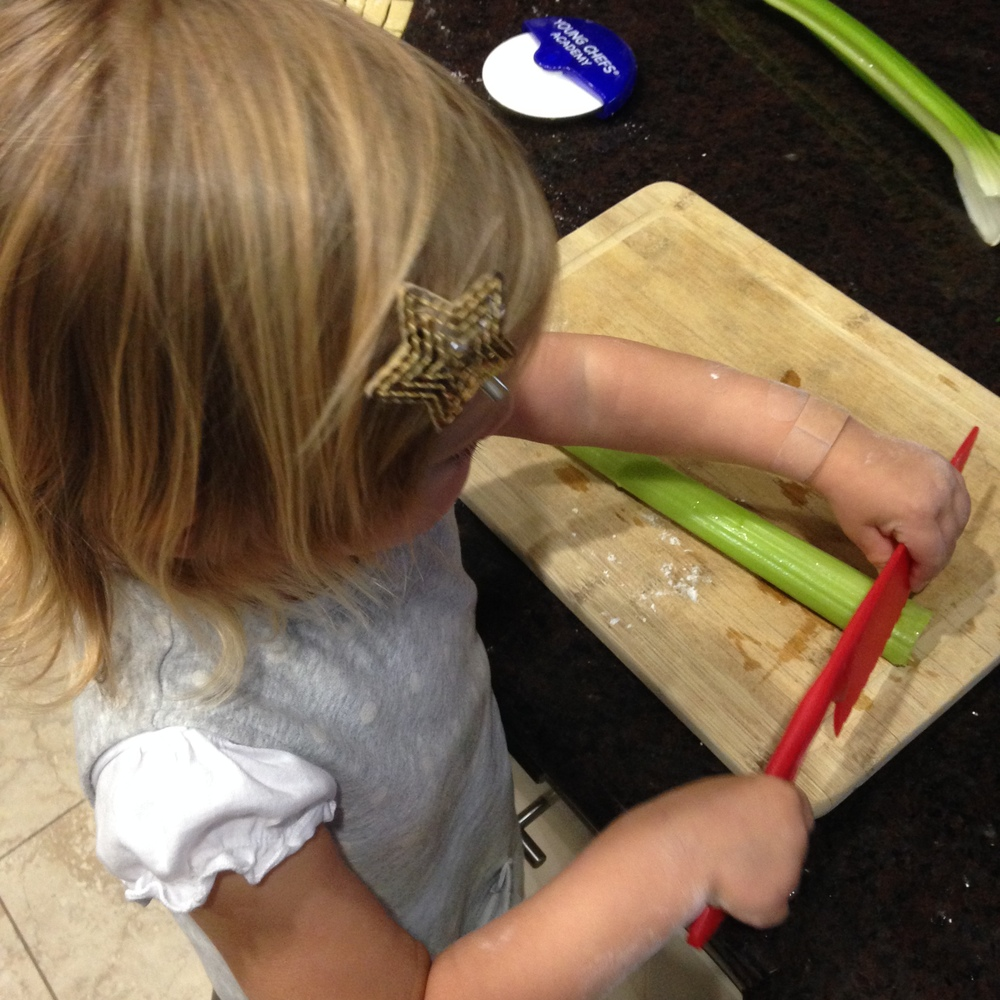 kiddo cutting celery