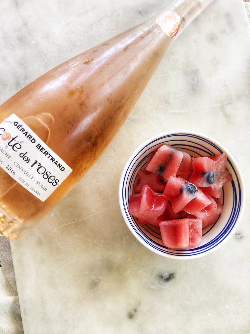 Living your best summer life sipping on Rose decorated with watermelon ice cubes.
