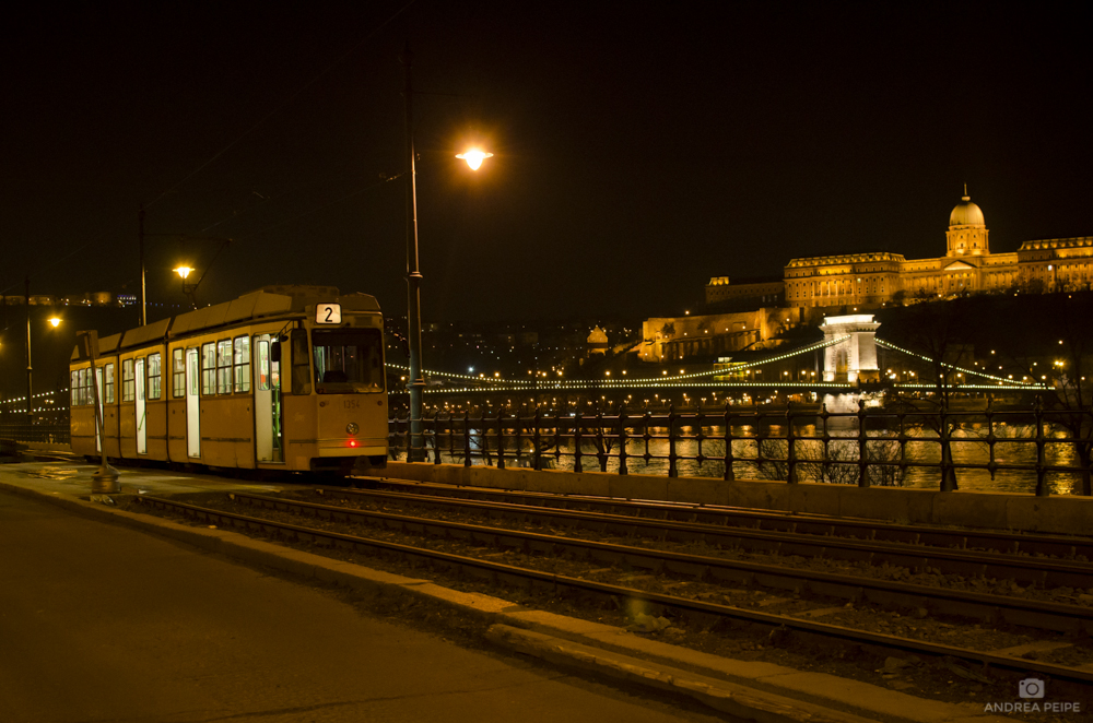 View of Buda Castle with one of the trams of the city