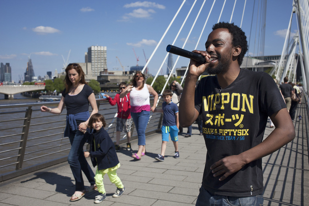 Rapper busing on the Golden Jubilee Bridge which links the South Bank to the West End of London.