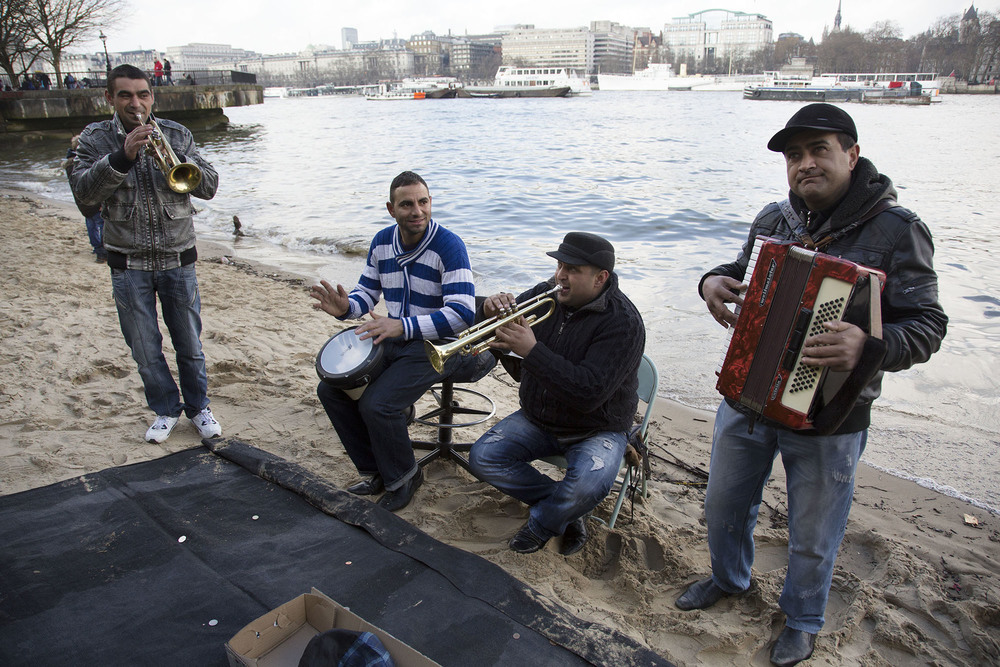 Romanian busking band play their traditional music on the South Bank beach.