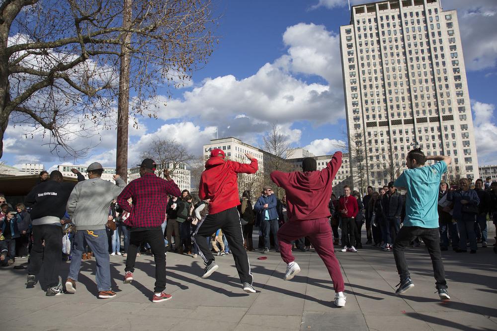 King Corville street performers perform a Gangnam Style street dance.