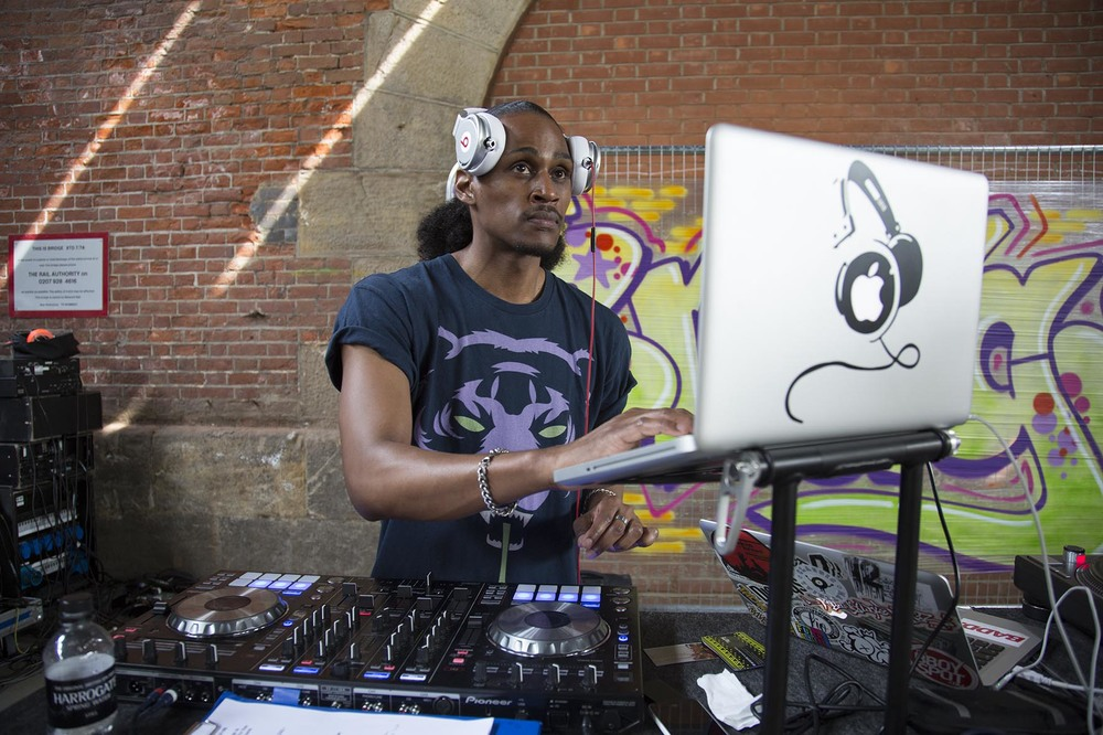 DJ3D lays down the music underneath Hungerford Bridge at the Urban Weekender.