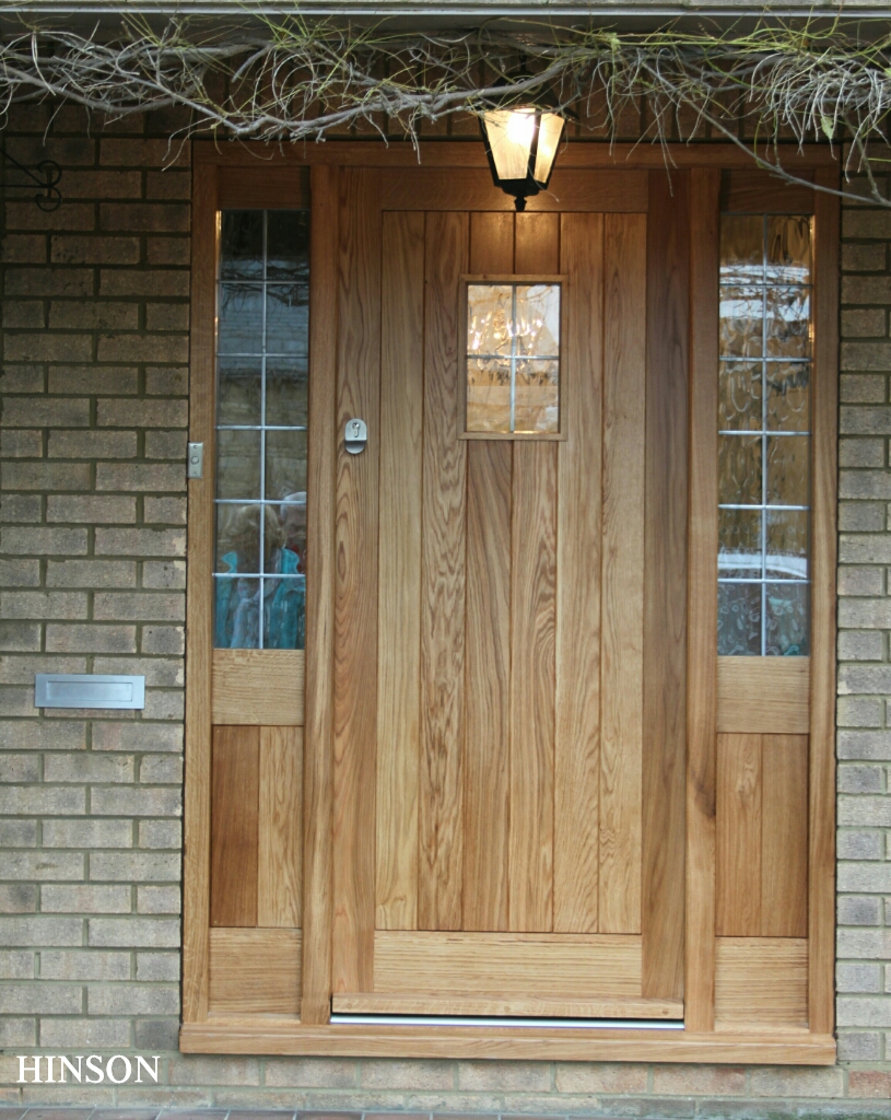 56mm thick Solid European oak     door and frame, the door and frame are now boarded both sides with thermal insulation in between. Two sets of draught seals around the door and toughened 24mm decorative Planitherm leaded light glass. All together creating a low U value to meet building regulations.