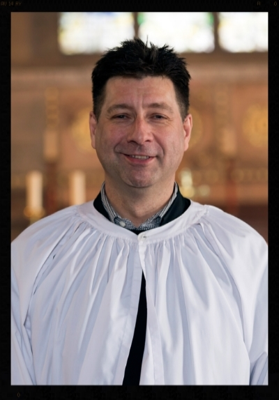 Neill Parrish - Director of Music and Organist. Neill oversees the musical life of our parish and directs our choir.