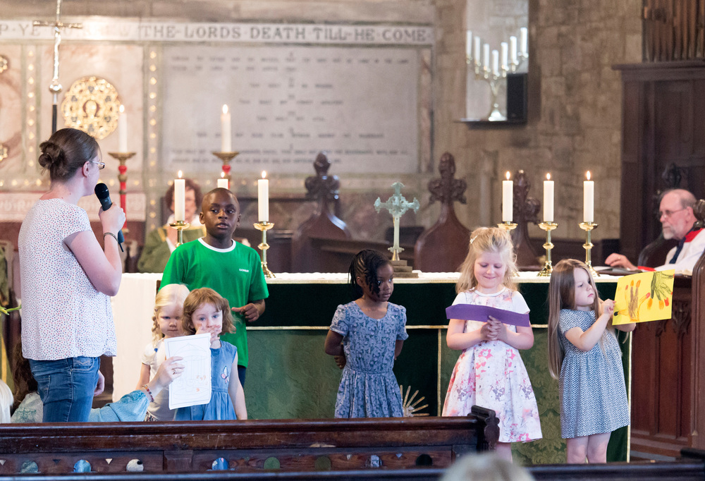 The children present their work during the parish mass